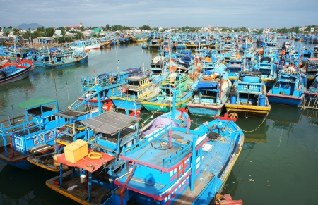 Many multicolor fishing boat anchor like a net at fishing port, with blue tone in horizontal frame.