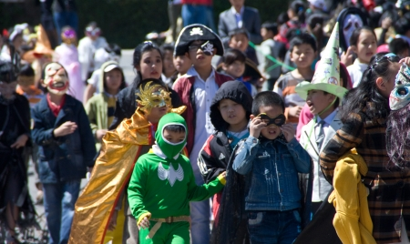 Children disguise oneself as film's character walking on street in the occasion of Halloween festival hole on by international school. October 30, 2011