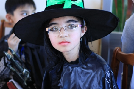 Little girl wear broad brimmed and the Death dress at party on the occasion of Halloween festival hole on by international school  October 30, 2011