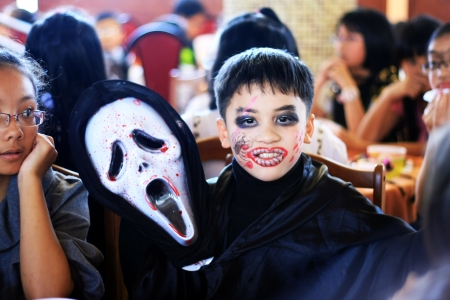 Schoolboy disguise oneself as the Death at party on the occasion of Halloween festival hole on by international school  October 30, 2011