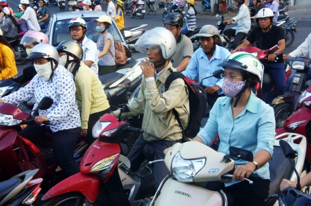 hon: People wear helmet and ride motorbike moving with confusion in rush hour at Sai Gon, , March 27, 2013