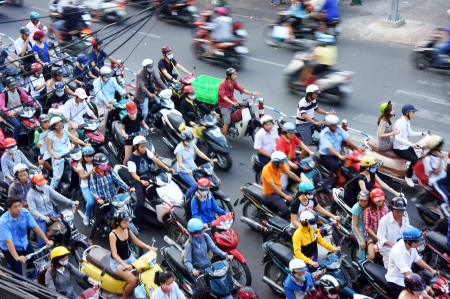 Citizen wear helmet move on streets by motorbike in rush hour at Sai Gon, March 27, 2013 Editorial