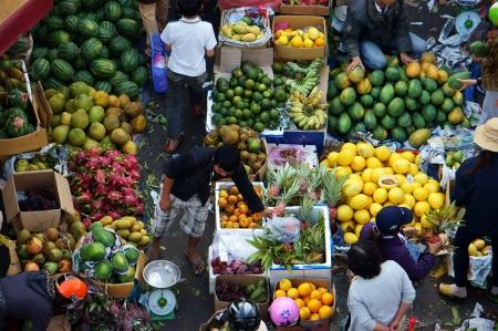 dalat: People sell and buy fruit at open air market, Dalat, Viet Nam- February 8, 2013
