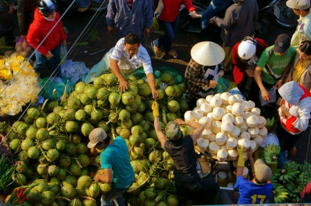 People sell and buy coconut fruit at open air market, Dalat, Viet Nam- February 8, 2013 Stock Photo - 23105760