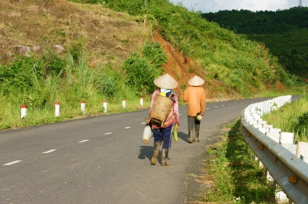 coming home:  People walking on countryside road to coming home after finish work in Viet Nam country side on September 4, 2012