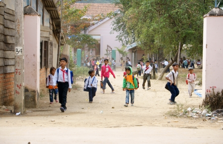 KHANH HOA, VIET NAM- FEBRUARY 5: Chidren has just school is out at countryside, they jump around out school, Khanh Hoa, Viet Nam, February 5, 2013