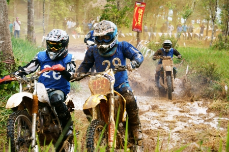 loc: BAO LOC, VIET NAM- DECEMBER 23 Racer in activity at motorcycle race hole on Bao Loc, Viet Nam, they try to across a marshy stretch of road with violent competition in December 23, 2012