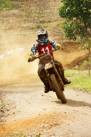 loc: BAO LOC, VIET NAM- DECEMBER 23: Racer in activity at motorcycle race hole on Bao Loc, Viet Nam in December 23, 2012