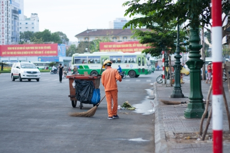 SAI GON, VIET NAM- APRIL 21: Sanitation worker cleanup rubbish on the street, in Sai Gon, Viet Nam, April 21, 2013