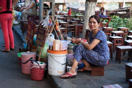 Food vendor sell Mi Quang on sidewalk, Hoi An, May 13, 2012