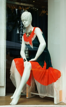shopwindow: Mannequin wear stylish clothes and necklace showed on shopwindow of fashion shop Stock Photo
