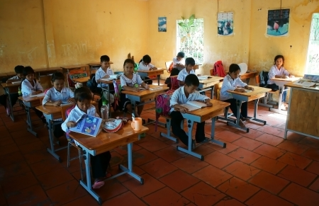 school time:  Primary pupil in school time of primary school in Long An, Viet Nam on Nov 11, 2013 Editorial