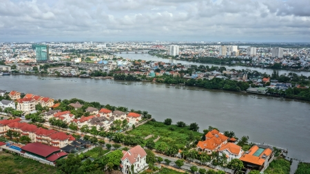 HO CHI MINH CITY ( SAI GON), VIET NAM- SEP 15: Cityscape of Ho Chi Minh city with Sai gon river among urban,  highrise buidling rise up to sky and serried of concrete house  in Ho Chi Minh, Vietnam on Sep 15, 2012