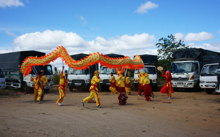 traditional custom: DA LAT, VIETNAM- JAN 31: Team of people perform dragon dance at truck park to celebrate New Year, this is oriental traditional custom to wish lucky , Viet Nam, Jan 31, 2014                            Editorial