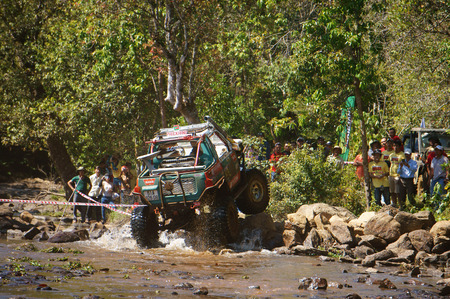 loc: BAO LOC, VIETNAM- FEB 24  Racer at terrain racing car competition,motor cross stream that extreme off road with rock on water, competitor  adventure in championship spirit, Viet Nam, Feb 24, 2014