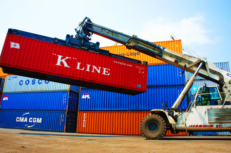 HO CHI MINH CITY, VIET NAM- MAR 19    Forklift truck crane container at  freight depot, cargo box in stack, this industrial port is logistic service of import, export  goods ,Vietnam, Mar 19, 2014