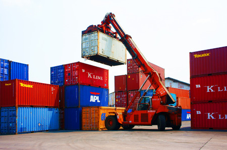 HO CHI MINH CITY, VIET NAM- MAR 19    Forklift truck crane container at Vietnam freight depot, cargo box in stack, this industrial port is logistic service of import, export  goods ,Vietnam, Mar 19, 2014 Editorial