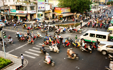 HO CHI MINH CITY, VIET NAM- MAR 27  Vehicle motion blur in urban, group of person wear helmet transfer by motorbike in chaotic, unsafe situation of town traffic, Sai Gon, Vietnam, Mar 27, 2014 Editorial
