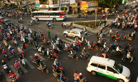 HO CHI MINH CITY, VIET NAM- MAR 27   Chaotic, crowded traffic in rush hour, crrowd of citizen transport by motorcycles, Ho chi Minh is big city with young population,  Vietnam, Mar 27, 2014 Editoriali