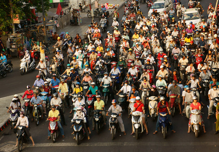 HO CHI MINH CITY, VIET NAM- MAR 27  Amazing, crowed  scene of urban traffic  in rush hour, crowd of people wear helmet, ride motorbike, stop at red light in waiting situation, Vietnam, Mar 27, 2014