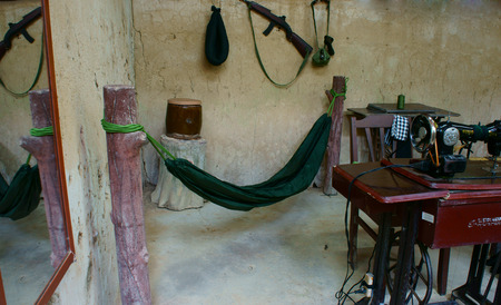 bowels: HO CHI MINH, VIET NAM- MAR 31  Underground tailor shop at Cu Chi tunnel, historic famous places in Vietnam war, army dig underground dug out, it Editorial