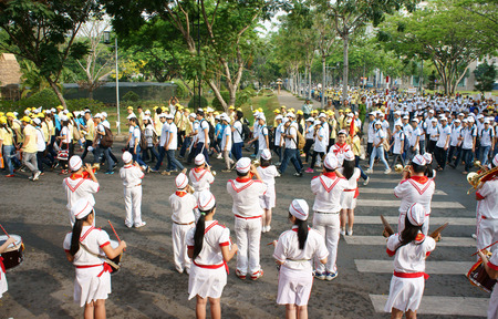 panpipe: HO CHI MINH, VIET NAM- APRIL 6  Group of teenager playing musical instruments as drum, clarinet, with white uniform, forage- cap, red tie, red flag they perform at social event, Vietnam, April 6, 2014 Editorial