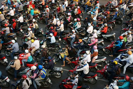trafic: HA HOI, VIET NAM- APRIL 18  Amazing trafic of Asia city, group citizen on private vehicle in rush hour, colorful scene, mob of person in helmet, transfer by motorcycle, Hanoi, Vietnam, April 18, 2014