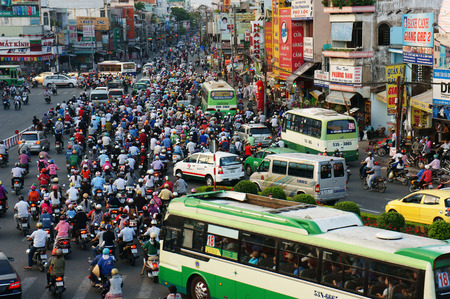 trafic: HO CHI MINH, VIET NAM- APRIL 18  Overview of urban trafic at Asia city, group Asian citizen on private vehicle in trafic jam, crowded, overloaded, mob of people move slow, Vietnam, April 18, 2014