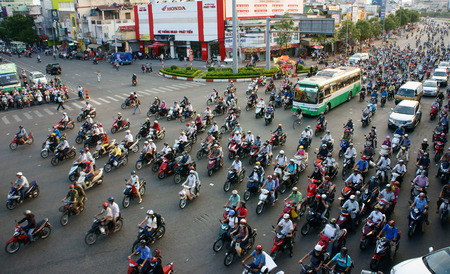 coming home: HO CHI MINH CITY, VIET NAM- APRIL 4  Circulation by private vehicle at Asia city, people transport by motorbike to coming home in row, crowded atmosphere after working day, Vietnam, April 18, 2014