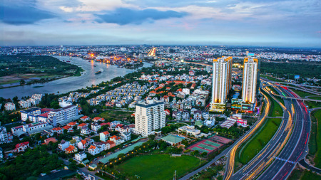 HO CHI MINH, VIETNAM- MAY 9  Impression panorama of big city, new urban with villas, building along Saigon river, traffic development , vehicle moving on road, overpass, canal, Viet Nam, May 9, 2014 Editorial
