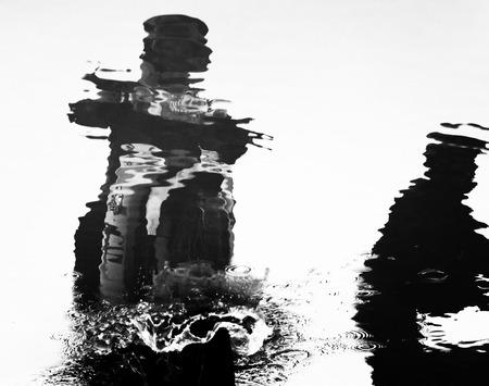 splash water: Virtual image, reflection silhouette of man riding motorbike on water, splash water