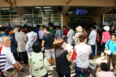 HO CHI MINH CITY, VIETNAM- JULY 9  Overload at Asia clinic, crowd of sick person standing, waiting to submit hospital fee, crowded of patient is situation, society problem, Viet Nam, July 9, 2014