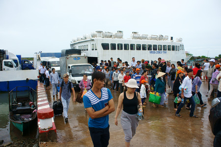 ferryboat: MEKONG DELTA, VIETNAM- JULY 23  Transportation passenger from Phu Quoc island to Ha Tien mainland by Thanh Thoi ferry boat, ferryboat transfer car, people, truck cross sea, Vietnam, July 23, 2014