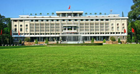 feudalism: HO CHI MINH CITY, VIETNAM- AUG 16  Beautiful landscape of Independence Palace, green grass, ancient architect, history building, Nguyen Van Thieu is last president of feudalism, Vietnam, Aug 16, 2014