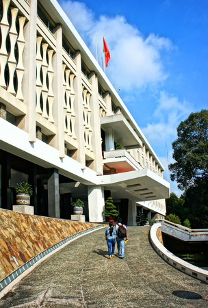 feudalism: HO CHI MINH CITY, VIETNAM- AUG 16  Amazing of Independence Palace, couple of tourist walk, ancient architect, history building, Nguyen Van Thieu is last president of feudalism, Vietnam, Aug 16, 2014