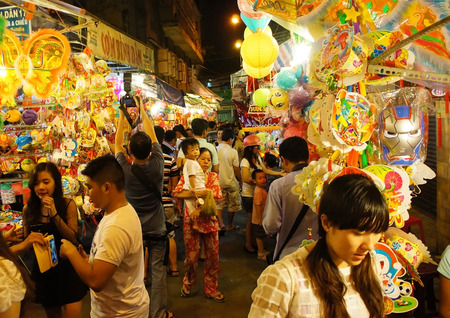 HO CHI MINH CITY, VIETNAM- AUG 16  Crowded atmosphere on Luong Nhu Hoc lantern street at night, people visit, take photo with colorful lantern, traditional culture on mid autumn, Vietnam, Aug 16, 2014