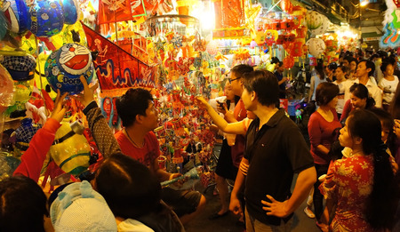 colorful lantern: HO CHI MINH CITY, VIETNAM- AUG 16  Crowded atmosphere on Luong Nhu Hoc lantern street at night, people visit, take photo with colorful lantern, traditional culture on mid autumn, Vietnam, Aug 16, 2014