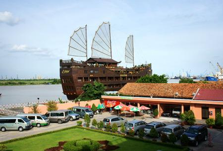 city park boat house: HO CHI MINH CITY, VIETNAM- AUG 10   Place for Vietnam travel at Ho Chi Minh city, campus of Nha Rong port, car park, houseboat as restaurant o river, Viet Nam,  Aug 10, 2014