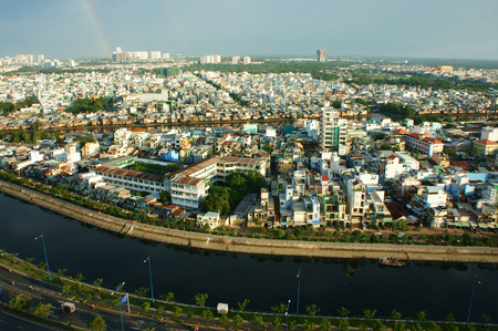 riverside landscaping: HO CHI MINH ,VIETNAM- AUG 7  Impression panaromic of Vietnamese city on day, group of house along Tau hu canal, amazing, abstract Asia panaromic from high view make colorful scene, Viet Nam,Aug 7,2014 Editorial