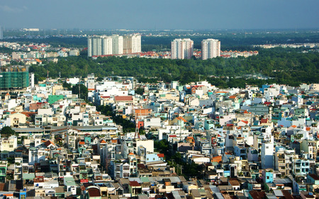 riverside landscaping: HO CHI MINH ,VIETNAM- AUG 7  Impression panaromic of Vietnamese city on day, group of house close together, amazing, abstract Asia panaromic from high view make colorful scene, Viet Nam,Aug 7,2014