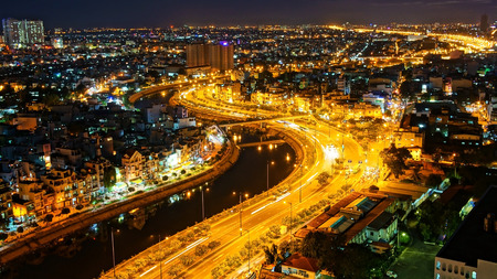 HO CHI MINH ,VIETNAM- AUG 7  Impression landscape of Asia city at night, group of house along Tau hu canal, yellow trail on street, panaromic from high view make colorful scene, Viet Nam,Aug 7,2014
