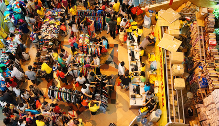 HO CHI MINH, VIETNAM- AUG 23: Crowded, busy atmosphere at Tax shoping centre, group of Asia people buy modern clothing  in sale off season, colorful store inside Tax center,  Vietnam, Aug 23, 2014