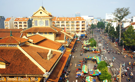 lon: HO CHI MINH CITY, VIETNAM- AUG 22: View of Binh Tay market- is wholesale markets at chinatown- on day, orange old tile roof, crowded motorbike on street, an ancient architect, Vietnam, Aug 22, 2014