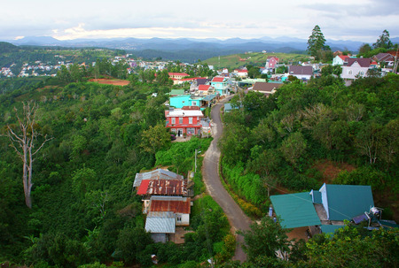 DA LAT, VIET NAM- SEPT 2: Scene of Dalat suburbs at evening, group of colorful house, country road, chain of mountain far away, countryside cover with green, fresh air, Vietnam, Sept 2, 2014 photo
