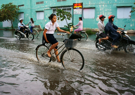 the flood tide: HO CHI MINH CITY, VIET NAM- OCT 9: Hard to circulate situation at Ho Chi Minh city when flood tide, flooded water on street, vehicle traffic in water, danger, unsafe scene, Vietnam, Oct 9, 2014