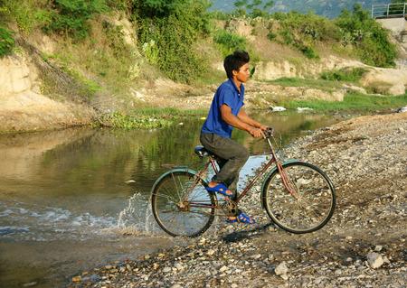 Phan Rang Viet Nam Oct 22 Asian Man Riding Bike Cross Stream