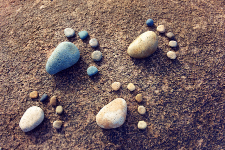 viet nam: Amazing concept from stone, group of pebble as family illustration, foot step on rock, funny toe, pretty idea for design