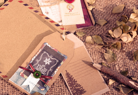 Amazing Christmas card from ancient material, paper envelop with vintage style, wooden pen, dry leaf,  abstract handmade Xmas card, send to friend with friendship and love photo