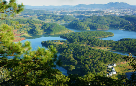 ecotourism: Fantastic landscape of eco lake for travel at Dalat, Viet Nam, fresh atmosphere, villa among forest, impression shape of hill and mountain from high view, wonderful vacation for ecotourism in spring
