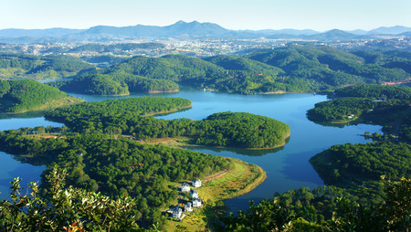 dalat: Fantastic landscape of eco lake for travel at Dalat, Viet Nam, fresh atmosphere, villa among forest, impression shape of hill and mountain from high view, wonderful vacation for ecotourism in spring
